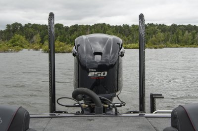 two power pole blades and a yamaha sho bolted to transom of skeeter bass boat