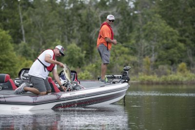 angler lands bass front the back deck of fx21