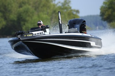 fast fishing boat runs across lake