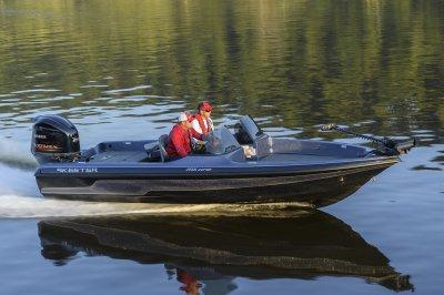 fast running deep v fishing boat runs across water
