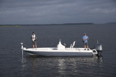 two men fishing from sx240 bay boat