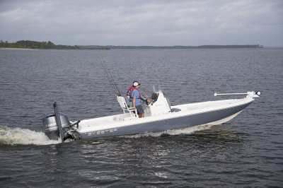 side view of sx240 bay boat getting up on plane