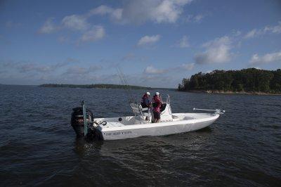 two men idling in skeeter sx230 bay boat