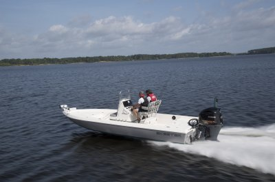 SX230 center console bay boat running down lake