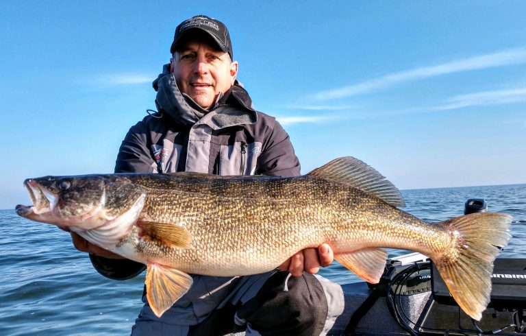 Sam Rutherford shows off nice Walleye caught from a Skeeter Deep V Boat